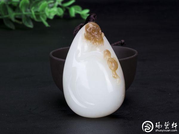古代和田玉籽料玉雕是否留皮?